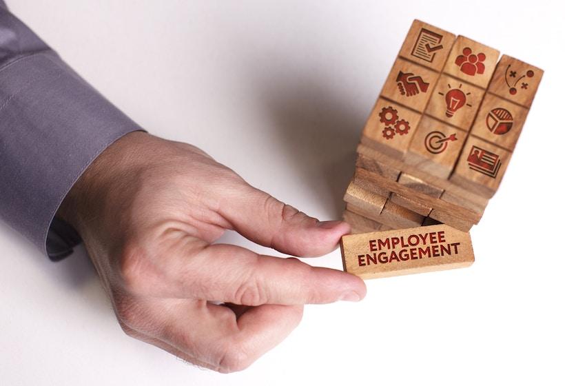 Man holding Employee Engagement building block