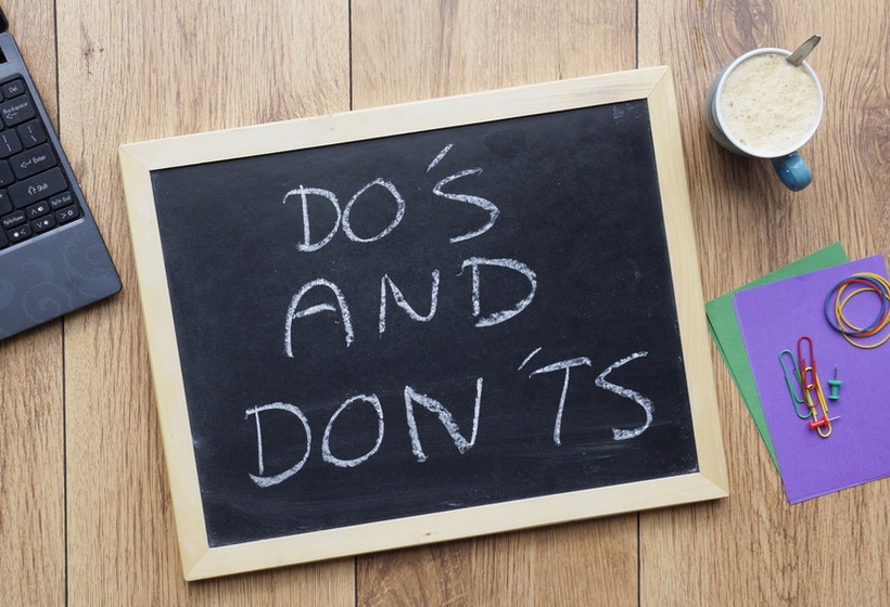 Do's and don'ts written on a chalkboard at the office.