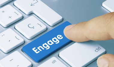 Laptop keyboard with a blue key 'Engage'