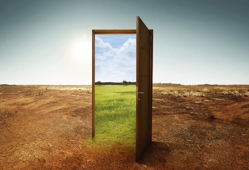 A door with a mirror in a field.