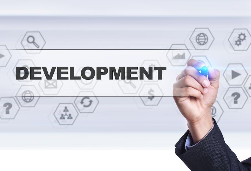 A screen with an employee writing development.