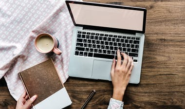 Woman working on her smart goal objectives using a laptop.