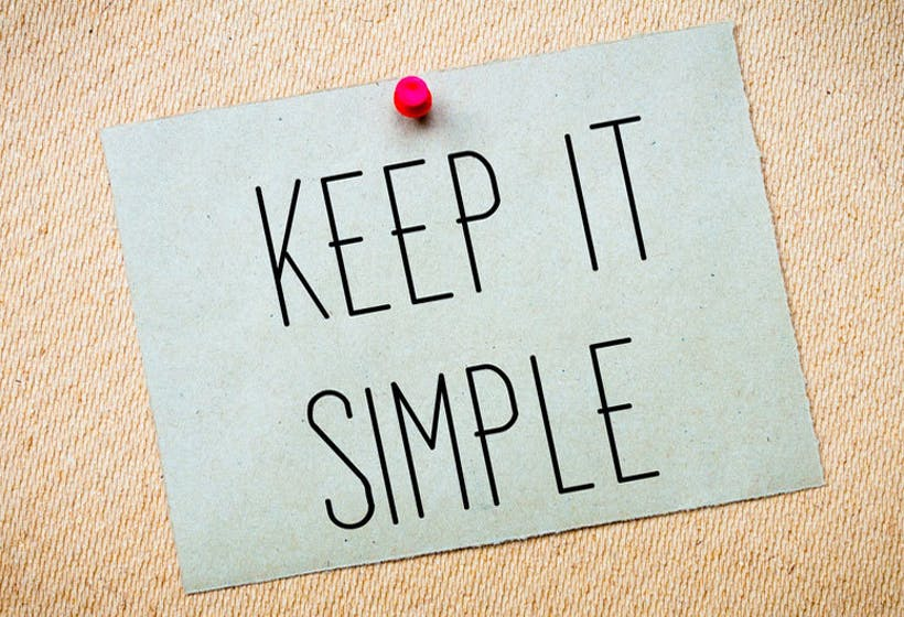 Post-it on a carton board with the words 'Keep it simple'.